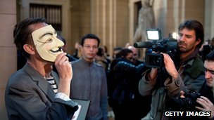Anonymous member protesting outside a French court
