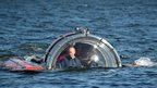 Russian President Vladimir Putin submerges on board a bathyscaphe off the island of Gogland in the Gulf of Finland