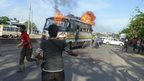 Protesters set fire to a bus in Dhaka