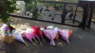 Floral tributes at the scene of a stabbing in Yardley