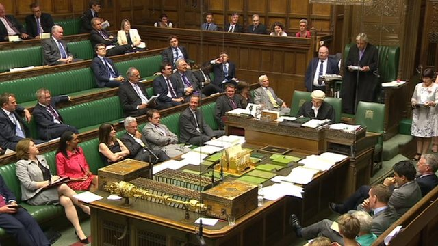 A wide shot of the Commons as the bill is passed