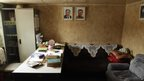 Portraits of late North Korean leaders Kim Il-sung and Kim Jong-il decorate an office aboard a North Korean-flagged ship