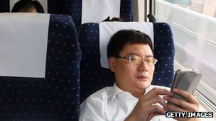 Man uses smartphone on train in China
