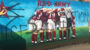 Defaced mural