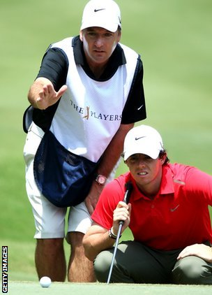 Rory McIlroy with caddie