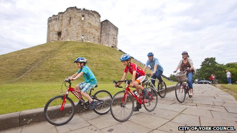 Cyclists at Clifford Tower, York