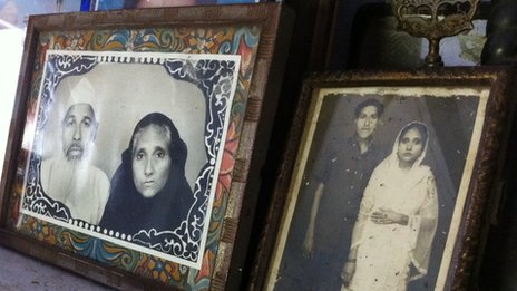 Frames with photos of Faizul Hasan Quadri and his wife Tajammuli Begum just before her death and (right) as a young couple