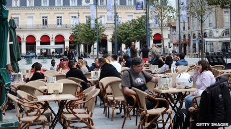 Lots of tables outside a French restaurant cafe