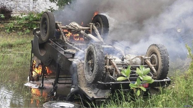 An overturned police jeep on fire and set ablaze by protesters in Chhapra in the the state of Bihar on 17 July 2013