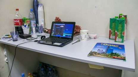 The desk in Mohammed's room at the airport