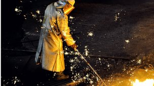 A man works at the blast furnace of the ArcelorMittal steel plant of Grande-Synthe, northern France