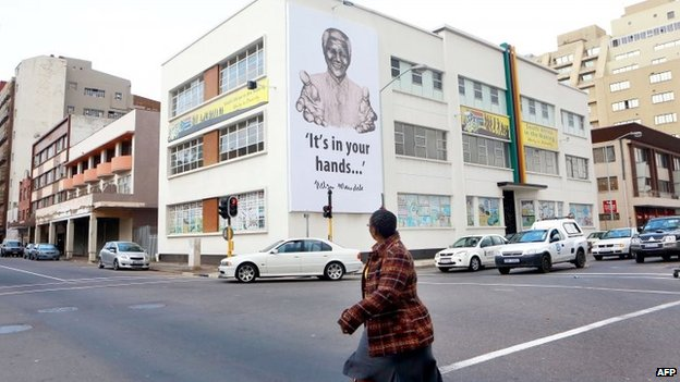 A huge banner of Nelson Mandela hangs over the Hindu Tamil Institute in Durban on 17 July 2013
