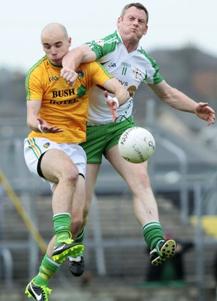 Leitrim's Robbie Lane is challenged by London forward Lorcan Mulvey