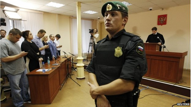 Russian protest leader Alexei Navalny (4th L) attends a court hearing in Kirov, July 18, 2013, as Judge Sergei Blinov gives his verdict
