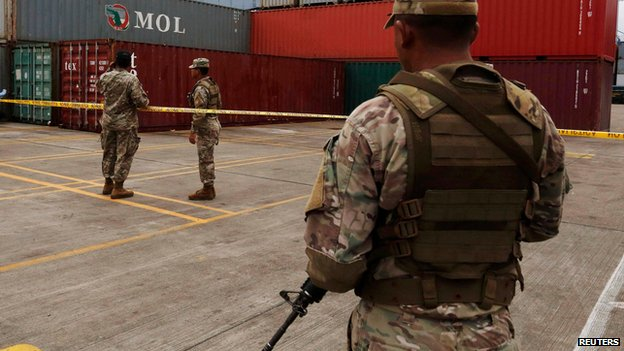 Panamanian soldiers guard cargo seized from North Korea ship, Colon City (17 July)