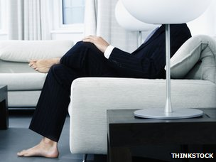 Businessman in suit with bare feet
