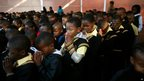 Pupils at the Denver primary school in Johannesburg pray for Nelson Mandela (18 July)