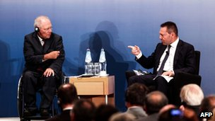 German Finance Minister Wolfgang Schaeuble (L) and Greek Finance Minister Yannis Stournaras speak at an event organised by the Greek-German chamber of commerce and industry in Athens on 18 July 2013