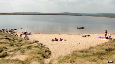 Sunbathers at Gaddings Dam reservoir, near Todmorden
