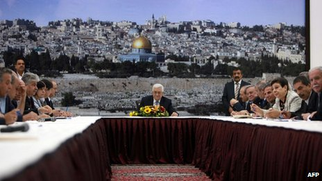 Palestinian president Mahmud Abbas smiles during a meeting with the Palestinian central committee in the West Bank city of Ramallah on July 18, 2013