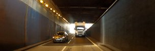 Lorry and car going through one of the tunnels