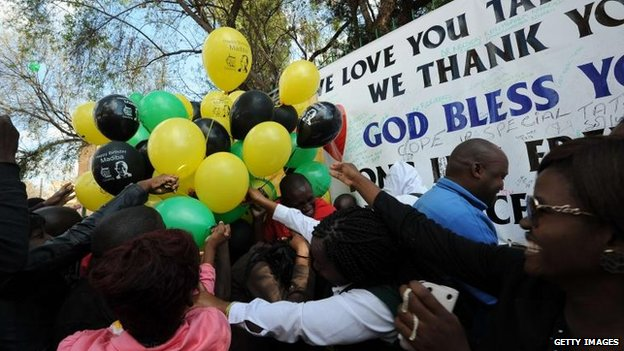 Well-wishers outside Mr Mandela's hospital, Pretoria (18 July)