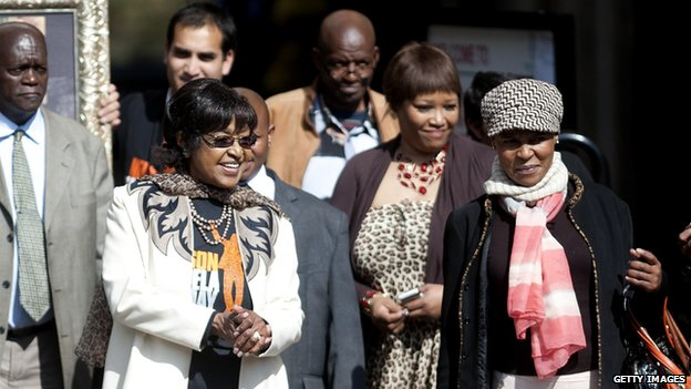 Winnie Madikizela-Mandela and members of Mr Mandela's family outside his hospital in Pretoria (18 July)