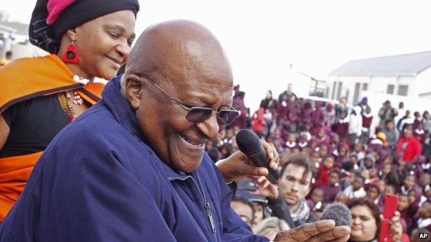 Archbishop Desmond Tutu celebrates Nelson Mandela's birthday at a primary school in Cape Town (18 July)