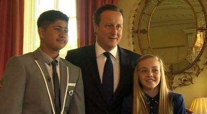 Two young reporters with Prime Minister David Cameron
