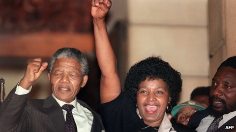 Nelson Mandela (L) and Winnie Madikizela-Mandela raise their fists on 11 February 1990 in Paarl, South Africa