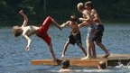 Youngsters frolic on a raft in in Calais, Vermont, on 16 July 2013