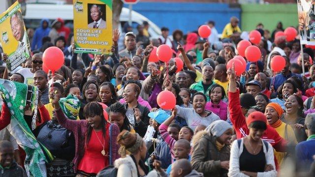People celebrating outside the hospital in Pretoria