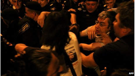 Police detain protestors in central Moscow late on July 18, 2013