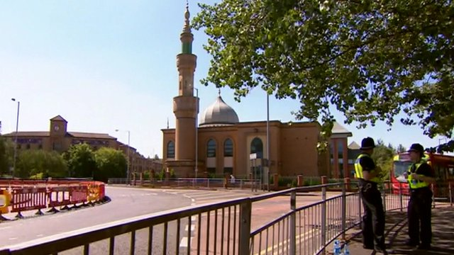 Police officers stand near Wolverhampton Central Mosque