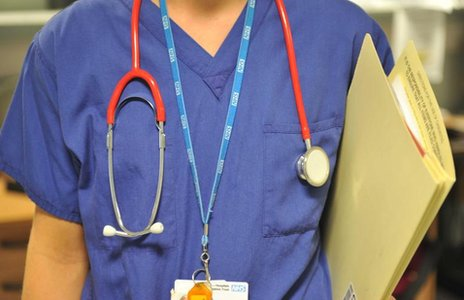 A woman doctor in scrubs