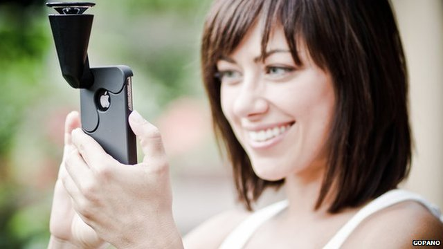 A woman using GoPano camera