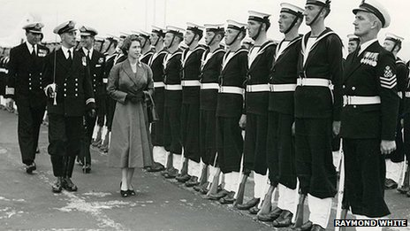 Queen Elizabeth II inspects sailors