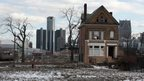 A boarded-up house is seen with the Detroit's city-centre skyline behind it. File photo from March 2013