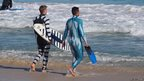Two surfers in Australia wear 'shark-proof' wetsuits
