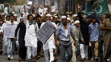 Muslims protest against the fatal shootings of four villagers by government troops on Thursday, in Jammu, India, Friday, July 19, 2013