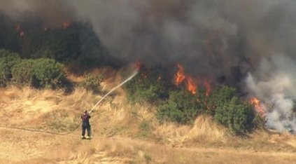 Firefighter tackles grass fire