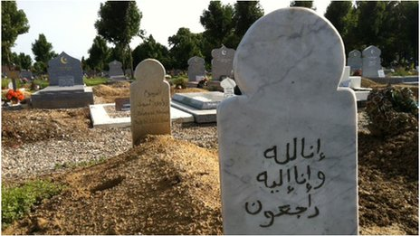 headstones with Arabic lettering