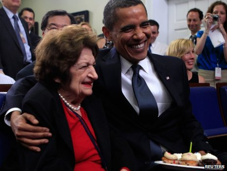 President Barack Obama puts his arm around Hearst White House columnist Helen Thomas after presenting her with cupcakes in honour of her birthday in the James Brady Briefing Room at the White House in Washington in this August 4, 2009 file photo.