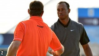 Lee Westwood and Tiger Woods shake hands at the end of their rounds