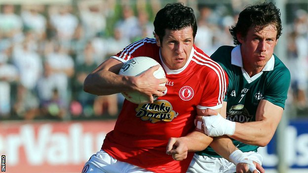Emmet Bolton challenges Sean Cavanagh at Newbridge