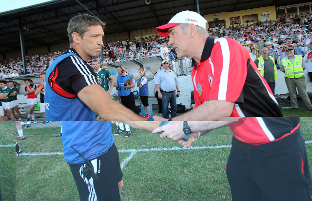 Mickey Harte shakes hands with Kildare manager Kieran McGeeney after Saturday's game in Newbridge