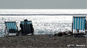 Sunbathers in Brighton on 20 July 2013