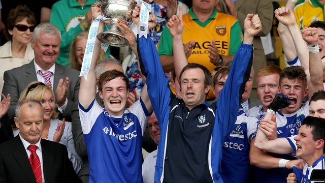 Kevin Loughran lifts the Father Murray Cup