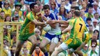 Donegal duo Karl Lacey and Anthony Thompson challenge Monaghan's Darren Hughes