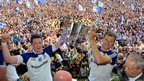 Owen Lennon and Conor McManus celebrate with the Anglo-Celt Cup in front of ecstatic Monaghan supporters